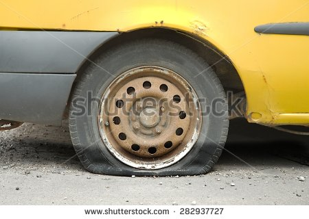 stock-photo-flat-tire-of-an-old-car-282937727