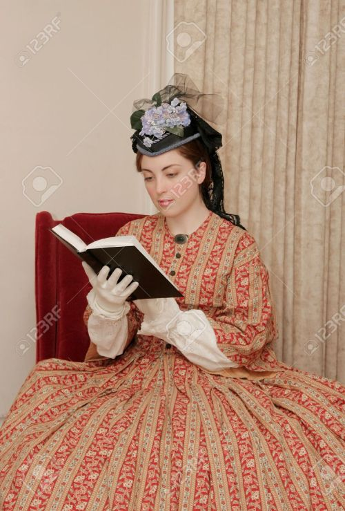 2918166-reenactor-playing-young-civil-war-era-woman-reading-a-book-stock-photo