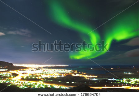 stock-photo-northern-lights-above-reykjavik-iceland-176694704