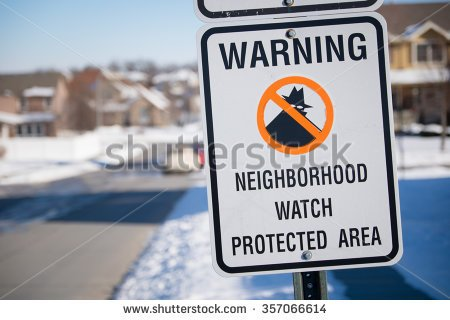 stock-photo-neighborhood-watch-sign-in-a-snowy-midwest-suburb-357066614