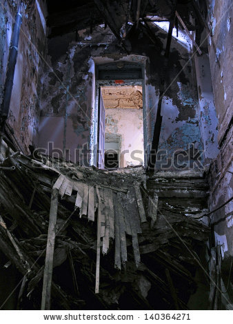 stock-photo-floating-doorway-above-a-collapse-inside-an-abandoned-mental-hospital-140364271