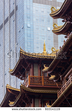 stock-photo-juxtaposition-of-old-versus-new-architecture-styles-modern-skyscraper-towering-above-a-traditional-603141119