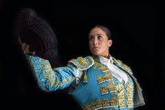 woman-bullfighter-salutes-his-montera-black-background-51103187