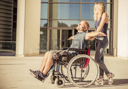 47119465-woman-and-his-boyfriend-on-the-wheelchair-going-out-concept-about-deseases-and-people