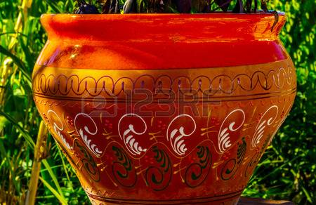 97394334-beautiful-ceramic-flower-pot-on-a-pedestal-with-flowers-decoration-of-urban-space-outdoor-decoration
