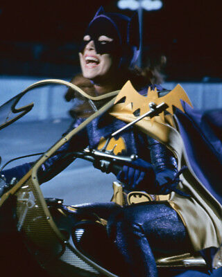 yvonne-craig-laughing-riding-motorcycle-as-batgirl-8x10